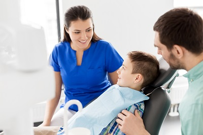young boy in dentist chair