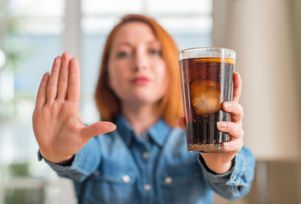 woman holding soda